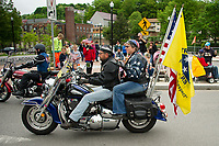 Riders from the NH Patriot Guard lead the Memorial Day parade down Main Street on Monday morning.  (Karen Bobotas/for the Laconia Daily Sun)