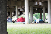 "A new ""tent city"" forms under I-45 south of downtown Dallas, Texas on May 15, 2016. (Cooper Neill for The Texas Tribune)"