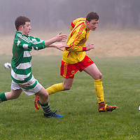 Avenue A's Mark Roche is pulled back by Rhine Rover's Conor Hanrahan