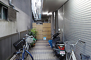 bicycles and scooter parked in alley Yokosuka Japan