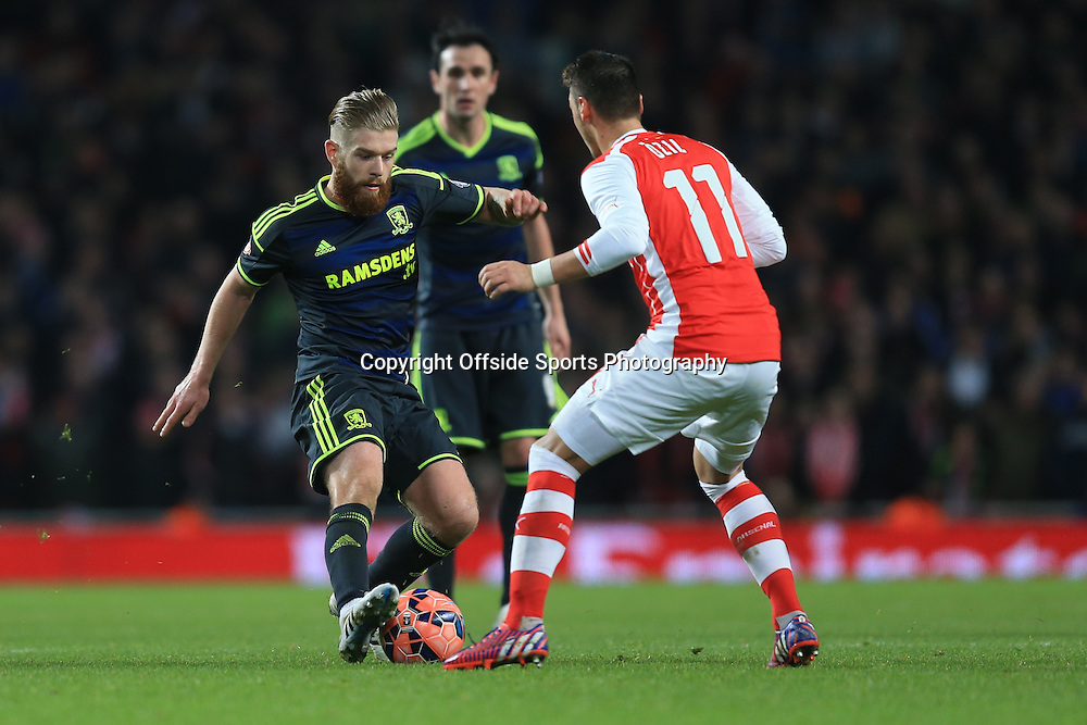 15 February 2015 - The FA Cup Fifth Round - Arsenal v Middlesbrough - Adam Clayton of Middlesbrough in action with Mesut Ozil of Arsenal - Photo: Marc Atkins / Offside.
