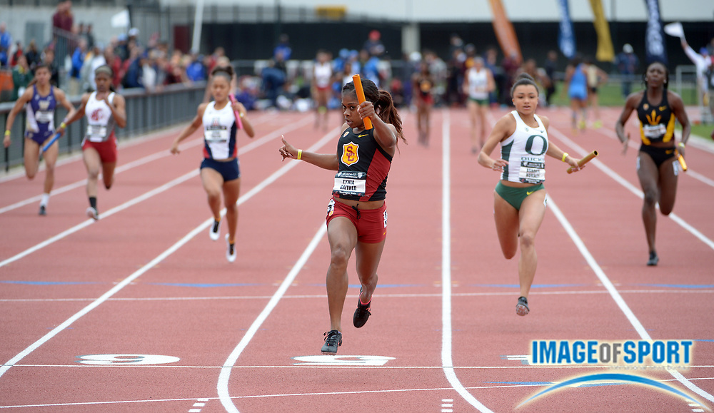 May 18, 2014; Pullman, WA, USA; Tynia Gaither of Southern California celebrates after running the anchor leg on the Southern California womens 4 x 100m relay that won in 43.21 in the 2014 Pac-12 Championships at the Mooberry Track & Field Complex.