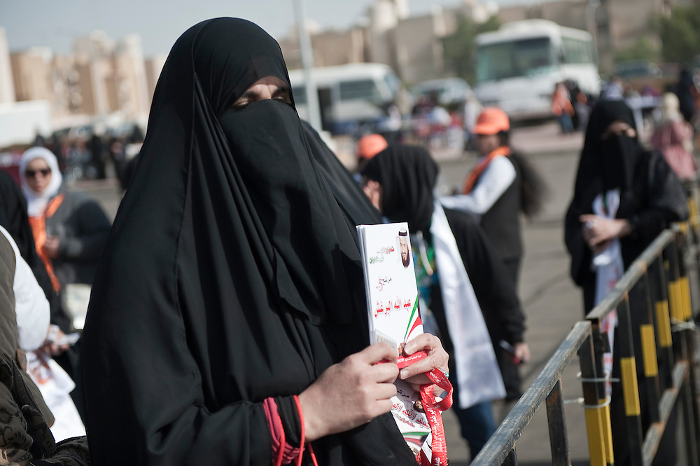 A candidate's supporter standing outside of a polling station in Kuwait City as voting proceeded during the February 2 parliamentary elections.  A total of 400,296 Kuwaiti men and women are eligible to vote to choose from among some 285 candidates for a new 50-seat National Assembly (parliament.