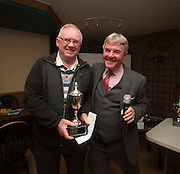 Eddie Ogg (president of the Belhaven Broughty Ferry Domino League) presents the Christmas Consolation Cup to Ian Hay of Gunners -  Belhaven Broughty Ferry Domino League prizegiving at the Crown, Monifieth<br /> <br />  - &copy; David Young - www.davidyoungphoto.co.uk - email: davidyoungphoto@gmail.com
