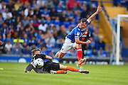 Portsmouth captain Michael Doyleevades a tackle in the second half  during the EFL Sky Bet League 2 match between Portsmouth and Barnet at Fratton Park, Portsmouth, England on 24 September 2016. Photo by Ian  Muir. during the EFL Sky Bet League 2 match between Portsmouth and Barnet at Fratton Park, Portsmouth, England on 24 September 2016. Photo by Ian  Muir.