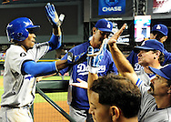 Sep. 27 2011; Phoenix, AZ, USA; Los Angeles Dodgers infielder Dee Gordon (3) is congratulated by teammates after scoring during the tenth inning against the Arizona Diamondbacks at Chase Field.  Mandatory Credit: Jennifer Stewart-US PRESSWIRE.