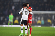 Derby County midfielder Ikechi Anya (8) and Bristol City defender Scott Golbourne (13) hug after the final whistle of the EFL Sky Bet Championship match between Derby County and Bristol City at the Pride Park, Derby, England on 11 February 2017. Photo by Jon Hobley.