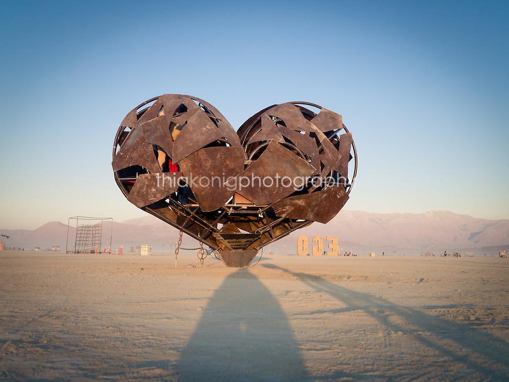 The metal sculpture Heartfullness at sunrise, Burning Man