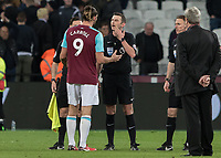 Football - 2017 / 2018 Premier League - West Ham United vs Stoke City<br /> <br /> Andy Carroll (West Ham United)  questions referee Michael Oliver about the 3 disallowed goals after the match official blows his whistle for full time at the London Stadium<br /> <br /> COLORSPORT/DANIEL BEARHAM