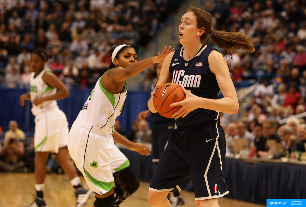 Breanna Stewart, Connecticut, challenged by Ariel Braker, Notre Dame, during the Connecticut V Notre Dame Final match won by Notre Dame during the Big East Conference, 2013 Women's Basketball Championships at the XL Center, Hartford, Connecticut, USA. 11th March. Photo Tim Clayton