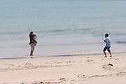 Udo, a small Island near Jeju-do. Tourists having fun on the beach.