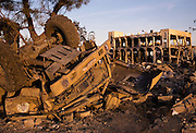 A destroyed Palestinain military transport truck lies amid the rubble of the Rafah Police headquarters complex, in Rafah, Gaza January 15, 2009. In the 20 days since the Israeli assault of Gaza, the Israeli Defense Forces have significantly targeted Palestinian infrastructure and civil authorities including the police force which was under the control of HAMAS.  Photo by Scott Nelson/World Picture Network for the New York Times.