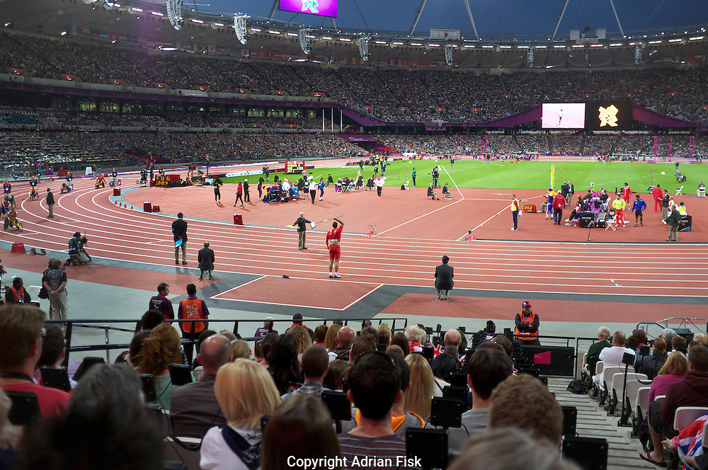 A Chinese paralympic athlete gets ready to throw the javalin in the Olympic stadium