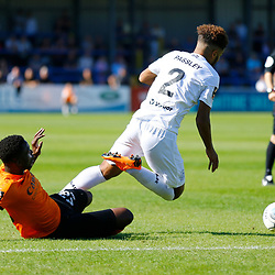 Barnets defender David Tutonda brings down Dovers defender Josh Passley to give away a free kick during the National League match between Dover Athletic and Barnet FC at Crabble Stadium, Kent on 1 September 2018. Photo by Matt Bristow.