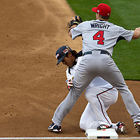 22 March 2009: #41 Atsunori Inaba of Japan collides with #4 David Wright of USA as he slides safely into third base during the 2009 World Baseball Classic semifinal game at Dodger Stadium in Los Angeles, California, USA. Japan wins 9-4 over Team USA.