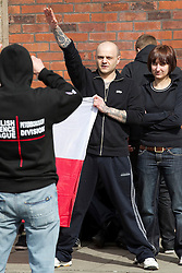 "© under license to London News Pictures. 02/04/2011: An EDL supporter poses for pictures and gives a Nazi salute after a rally in Blackburn. Credit should read ""Joel Goodman/London News Pictures""."