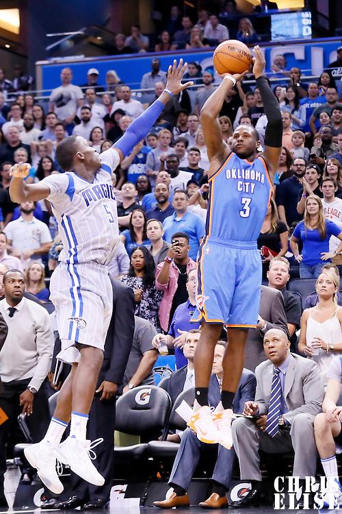 30 October 2015: Oklahoma City Thunder guard Dion Waiters (3) takes a jump shot over Orlando Magic guard Victor Oladipo (5) during the Oklahoma City Thunder 139-136 double overtime victory over the Orlando Magic, at the Amway Center, in Orlando, Florida, USA.