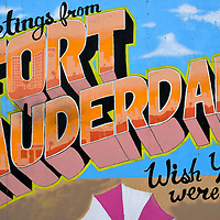 Greetings From Fort Lauderdale Mural in Fort Lauderdale, Florida<br /> I vividly remember two icons of traveling when I was a kid.  One was the postcard.  They often looked like this mural on the side of the Tattoo Blues shop in Fort Lauderdale. I always wrote &ldquo;Wish You Were Here&rdquo; not because that&rsquo;s what I really wanted but just to taunt the recipient.  The second was &ldquo;Kodak Film Sold Here.&rdquo;  Ah, I miss those days.