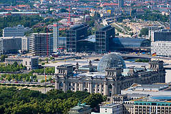 View of the Reichstag German Parliament building and Hauptbahnhof main Railway Station  in Berlin, Germany.