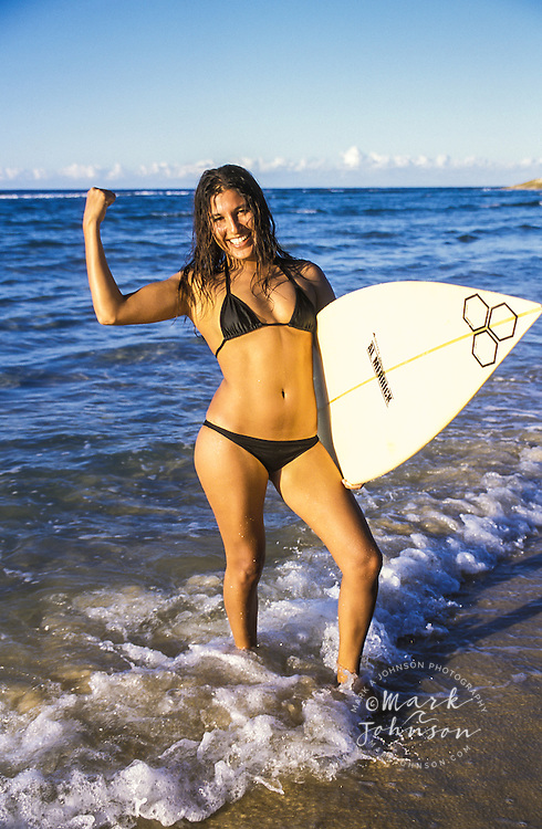 Australia, Queensland, N. Stradbroke Island, female surfer portrait.  MR available