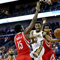 Jan 25, 2016; New Orleans, LA, USA; New Orleans Pelicans guard Norris Cole (30) passes as Houston Rockets forward Clint Capela (15) and guard Patrick Beverley (2) defend during the second half of a game at the Smoothie King Center. The Rockets defeated the Pelicans 112-111. Mandatory Credit: Derick E. Hingle-USA TODAY Sports