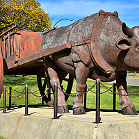"""Red River Ox Cart Sculpture in Winnipeg, Canada <br /> For fifty years starting in 1820, the Red River Trails were a muddy network of """"roads"""" stretching from today's Winnipeg to the Mississippi River at my home town of St. Paul, Minnesota.  Fur traders navigated these treacherous paths using the Red River ox cart. The wooden frames were held together by buffalo hides and could carry up to 1,200 pounds. This sculpture was erected in 1974 at Assiniboine Park as part of Winnipeg's centennial celebration."""