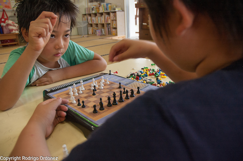 Two boys play chess at a child care center (gakudo) in Rikuzentakata, Japan.