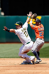 OAKLAND, CA - MAY 01:  Yonder Alonso #17 of the Oakland Athletics is forced out by Jose Altuve #27 of the Houston Astros at second base during the second inning at the Oakland Coliseum on May 1, 2016 in Oakland, California. (Photo by Jason O. Watson/Getty Images) *** Local Caption *** Yonder Alonso; Jose Altuve