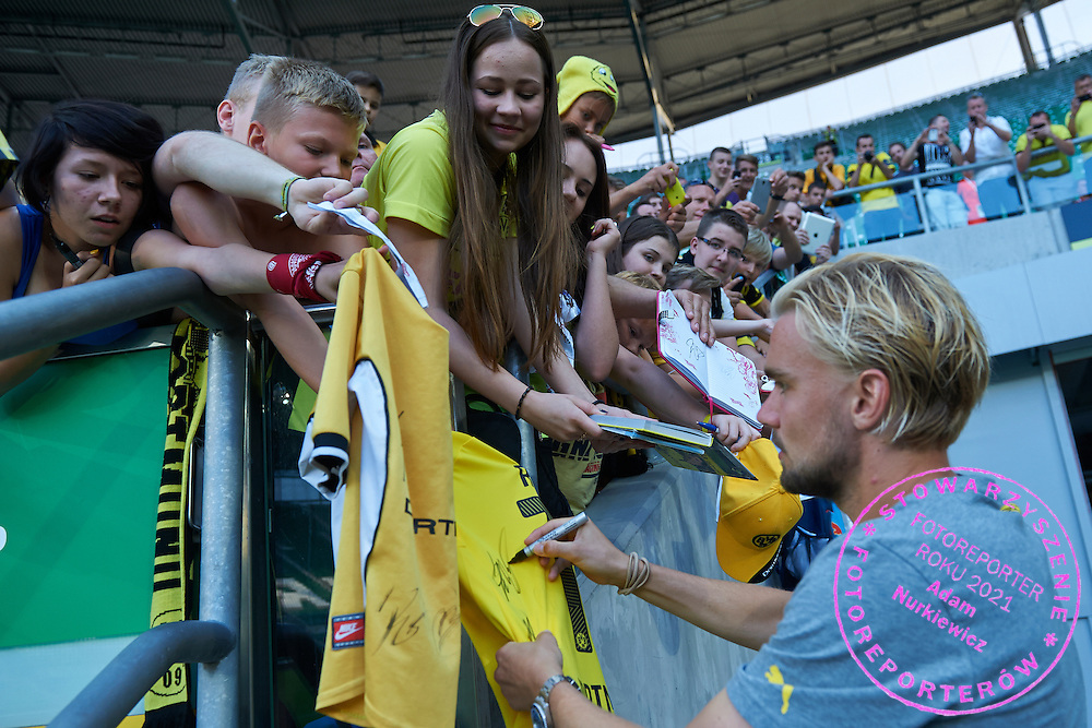 Marcel Schmelzer of Dorussia Dortmund signs his autographs for Dorussia Dortmund's supporters after international friendly soccer match between WKS Slask Wroclaw and BVB Borussia Dortmund on Municipal Stadium in Wroclaw, Poland.<br /> <br /> Poland, Wroclaw, August 6, 2014<br /> <br /> Picture also available in RAW (NEF) or TIFF format on special request.<br /> <br /> For editorial use only. Any commercial or promotional use requires permission.<br /> <br /> Mandatory credit:<br /> Photo by &copy; Adam Nurkiewicz / Mediasport