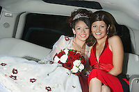 Bride with mother in limousine