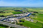 Nederland, Utrecht, Eemnes, 09-06-2016;  Eembruge met riviertje de Eem en de A1 in de voorgrond. Arkemheen-Eemland.  <br /> Polder landscape between Utrecht and Amsterdam.<br /> <br /> luchtfoto (toeslag op standard tarieven);<br /> aerial photo (additional fee required);<br /> copyright foto/photo Siebe Swart