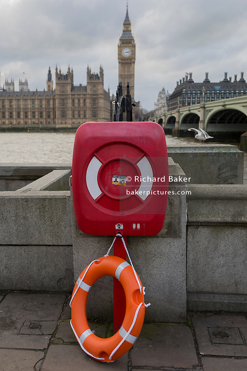 A lifebuoy lies dangling on the ground with the River Thames and the British Houses of Parliament in the background, on 2nd february 2017, in London, England.