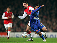 Photo: Tom Dulat/Sportsbeat Images.<br /> <br /> Arsenal v Steaua Bucharest. UEFA Champions League. 12/12/2007.<br /> <br /> Vasilica Cristocea of Steaua Bucharest and Robin Van Persie of Arsenal with the ball.