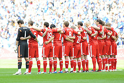 Liverpool players respect a minute's silence for the 96 victims of the Hillsborough disaster before the kick off the Budweiser FA Cup semi final match between Liverpool and Everton at Wembley on Saturday 14 April 2012 (Photo by Rob Munro)