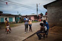 Daily life on the streets of a Garifuna community on January 25, 2013  in Corozal, Honduras. (David Rochkind/ Pulitzer Center)