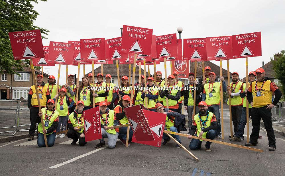 Volunteers Group Shot  at 1 mile  . The Virgin Money London Marathon, 23rd April 2017.<br /> <br /> Photo: Dave Shopland for Virgin Money London Marathon<br /> <br /> For further information: media@londonmarathonevents.co.uk