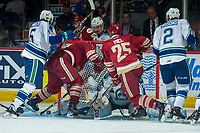 REGINA, SK - MAY 19: Jeffrey Truchon-Viel #25 and Liam Murphy #61 of Acadie-Bathurst Titan work to put the puck past Stuart Skinner #74 of Swift Current Broncos during overtime at the Brandt Centre on May 19, 2018 in Regina, Canada. (Photo by Marissa Baecker/CHL Images)