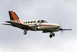 Cessna 414A Chancellor (registration N414EE) landing at Palo Alto Airport (KPAO), Palo Alto, California, United States of America