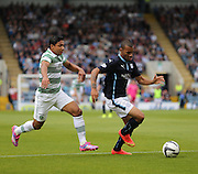 Dundee's Phil Roberts bursts away from Celtic's Emilio Izaguirre - Dundee v Celtic SPFL Premiership at Dens Park<br /> <br />  - &copy; David Young - www.davidyoungphoto.co.uk - email: davidyoungphoto@gmail.com
