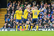 Scunthorpe players surround the referee Craig Pawson claiming a penalty during the The FA Cup third round match between Chelsea and Scunthorpe United at Stamford Bridge, London, England on 10 January 2016. Photo by Shane Healey.