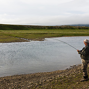 Tómas Guðmundsson catching an atlantic salmon at the pool Malarsveigur on the river Breiðdalsá, Iceland.