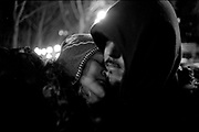 Michelle and Victor share a tender moment while waiting in line for rice and beans in Seattle's Pioneer Square neighborhood on the coldest night of the year, where temperatures sank to 25* F. The two had been kicked out of their apartment the day before after complaining about conditions to their landlord, and were on the street until they could find an open apartment that would accept their state housing voucher.