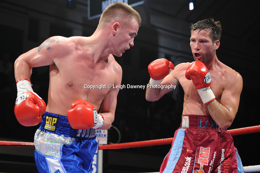 Light Welterweight boxer Frankie Gavin (blue shorts) defeat Michael Lomax at York Hall, Bethnal Green, London on the 19th February 2011. Frank Warren Promotions. Photo credit © Leigh Dawney.