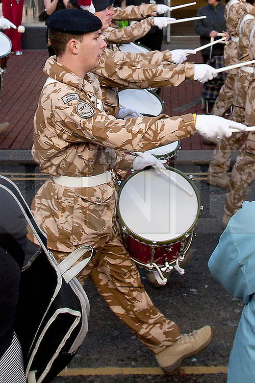 © London News Pictures. Private LEE RIGBY (centre), a drummer in the the Royal Regiment of Fusiliers, taking part in a march through Hounslow, London on 26 November 2009, when the regiment was granted the Freedom of the Borough after returning from a tour of duty in Afghanistan. Michael Adebowale and Michael Adebolajo are standing  trial at The Old Bailey in Central London accused of murdering Drummer Lee Rigby. Photo credit: London News Pictures