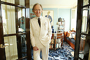 Author Tom Wolfe poses for a photograph in his New York apartment, Wednesday, Nov. 3, 2004. (Photo by Diane Bondareff for The Toronto Star)