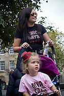 A young girl in a buggy with a small tartan hat waiting on the Royal Mile prior to the start of a pro-Independence march and rally in the Scottish capital. The event, which was staged in support of the pro-Independence movement, was attended by an estimated by approximately 30,000 people. The referendum to decide whether Scotland will become an independent nation will be staged on 18th September 2014.