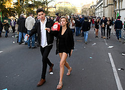 © London News Pictures. 01/05/2016. Oxford, UK. A young man and woman make their way home following  May Day in the early hours of the morning near Magdalen Bridge in Oxford, Oxfordshire. This year people were again prevented from jumping from the bridge in to the water due to serious injuries sustained at a previous years event . Photo credit: Ben Cawthra/LNP