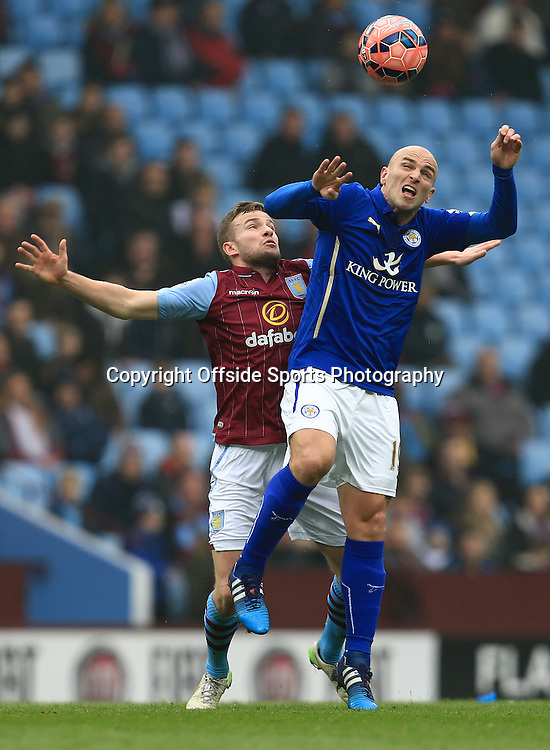 15th February 2015 - FA Cup 5th Round - Aston Villa v Leicester City - Esteban Cambiasso of Leicester City and Tom Cleverley of Aston Villa battle for the ball - Photo: Paul Roberts / Offside.