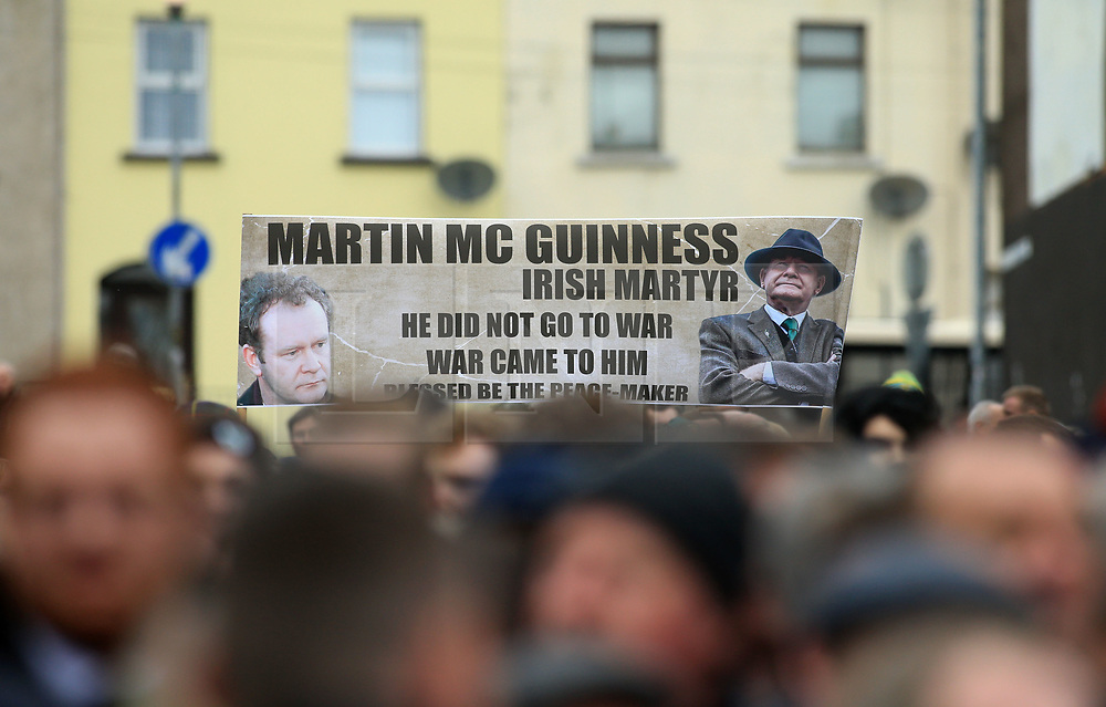 © Licensed to London News Pictures. 23/03/2017. Londonderry, UK. The funeral of Sinn Fein's Martin McGuinness at St Columba's Long Tower church in Londonderry, Northern Ireland. Mr McGuinness, a former IRA leader turned politician, died on Tuesday. Photo credit: LNP