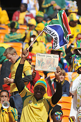 JOHANNESBURG, SOUTH AFRICA - Friday, June 11, 2010: A South Africa supporter with during the opening Group A match between South Africa and Mexico during the 2010 FIFA World Cup South Africa at the Soccer City Stadium. (Pic by Hoch Zwei/Propaganda)